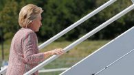 U.S. Democratic presidential candidate Hillary Clinton boards her campaign plane in White Plains, New York, United States September 15, 2016, to resume her campaign schedule following a bout with pneumonia.  REUTERS/Brian Snyder