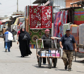 Iraq finance minister fights on two fronts