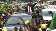 Tanzania's President elect John Pombe Magufuli (C) salutes members of the ruling Chama Cha Mapinduzi Party (CCM) as he arrives at the party's sub-head office on Lumumba road in Dar es Salaam, October 30, 2015. Tanzania's ruling party candidate, John Magufuli, was declared winner on Thursday of a presidential election, after the national electoral body dismissed opposition complaints about the process and a demand for a recount. The election has been the most hotly contested race in the more than half a century of rule by the Chama Cha Mapinduzi Party, which fielded Magufuli, 56, a minister for public works. REUTERS/Emmanuel Herman - RTX1TYDX
