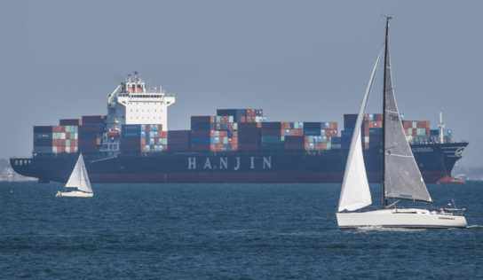 One Hanjin deliver starts unloading in Long Seaside, at the same time as others are still anchored offshore