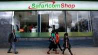 Pedestrians walk past a mobile phone care centre operated by Kenyan's telecom operator Safaricom in the central business district of Kenya's capital Nairobi, May 11, 2016. REUTERS/Thomas Mukoya - RTX2DUJ6